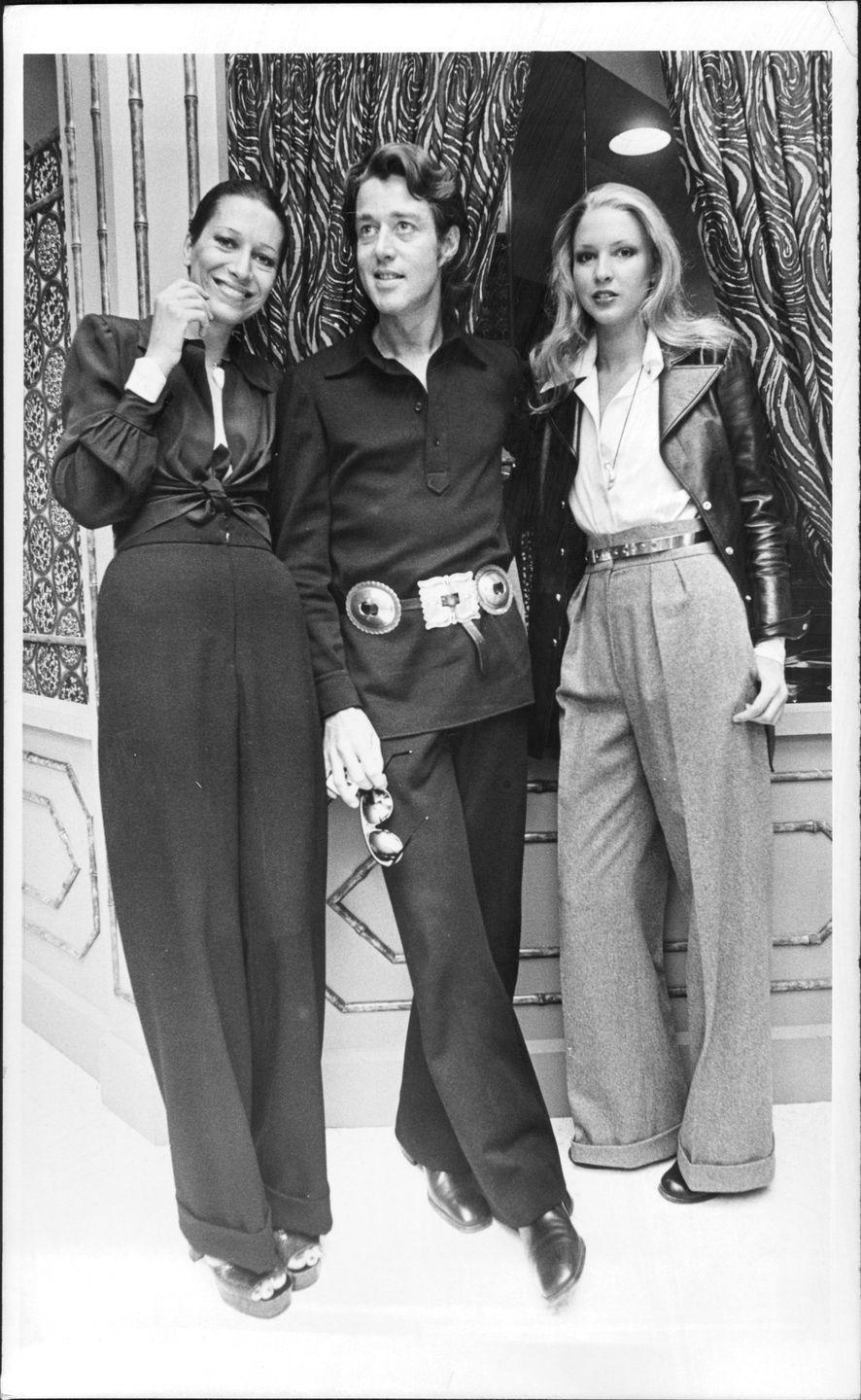 """<p>Halston was close friends with famed jewelry designer <a href=""""https://www.townandcountrymag.com/style/jewelry-and-watches/a7294/tiffanys-elsa-peretti-interview/"""" rel=""""nofollow noopener"""" target=""""_blank"""" data-ylk=""""slk:Elsa Peretti"""" class=""""link rapid-noclick-resp"""">Elsa Peretti</a>. He's pictured here with Peretti (left).</p>"""