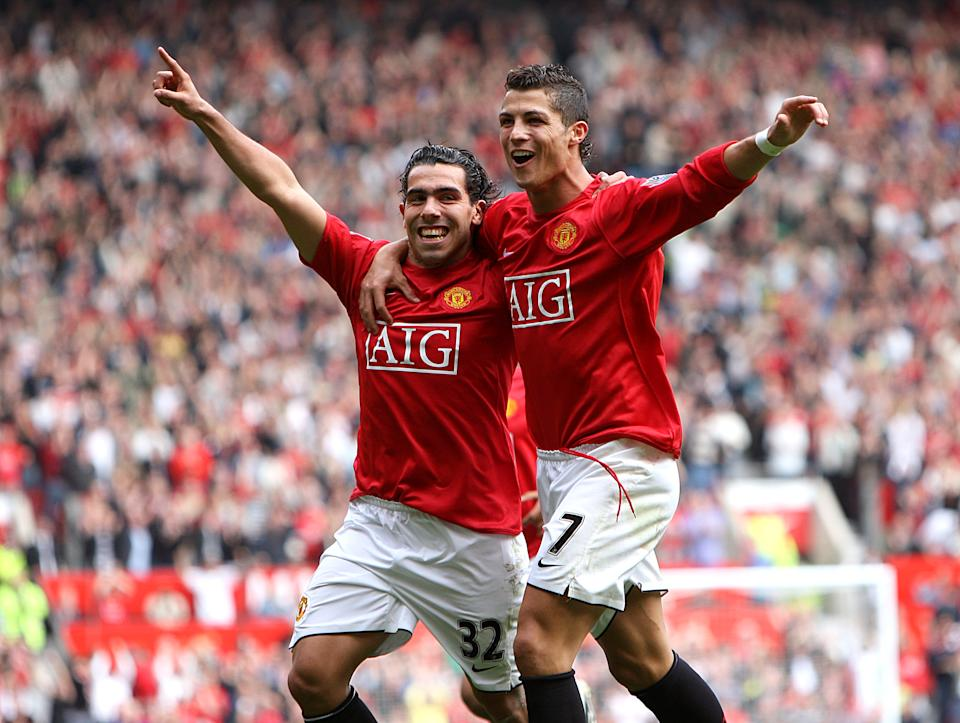 Manchester United's Carlos Tevez celebrates scoring the opening goal of the game with Cristiano Ronaldo (Photo by John Walton - PA Images via Getty Images)