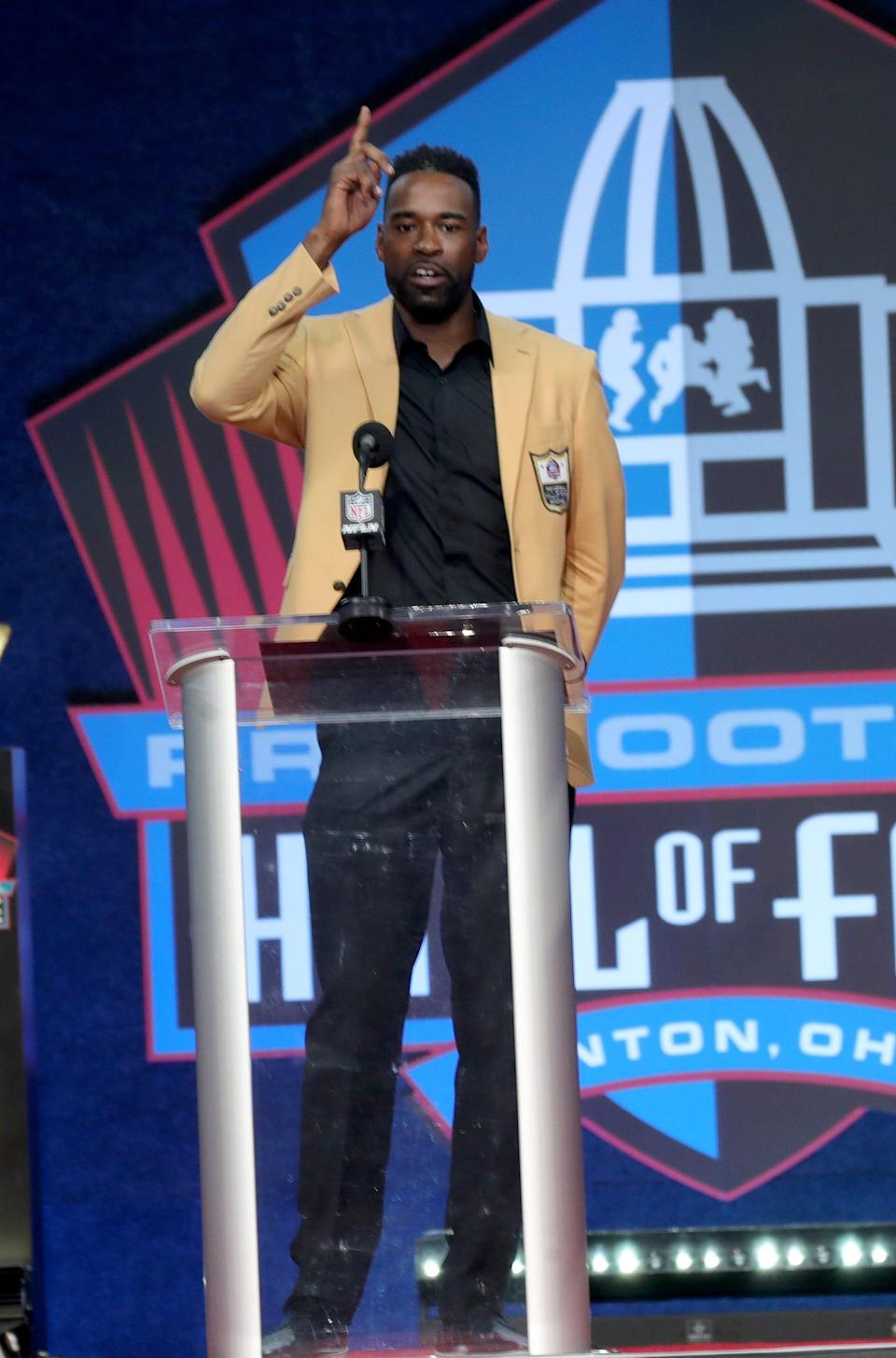 Former Detroit Lion Calvin Johnson gives his speech during the Pro Football Hall of Fame enshrinement ceremony Sunday, Aug. 8, 2021 at Tom Benson Hall of Fame Stadium in Canton, Ohio.