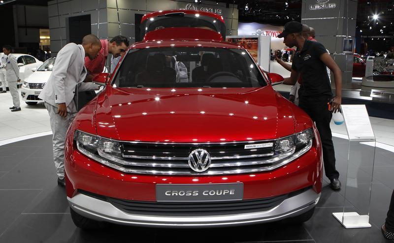 Visitors look at Volkswagen's Cross Coupe during the media preview of the Johannesburg International Motor Show, in Johannesburg