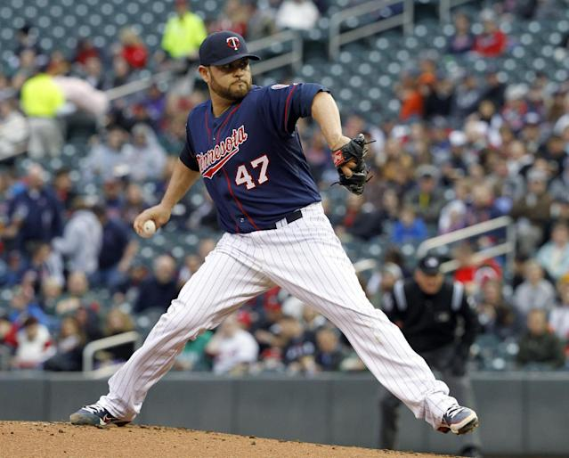 Minnesota Twins starting pitcher Ricky Nolasco delivers to the Baltimore Orioles during the first inning of a baseball game, Friday, May 2, 2014, in Minneapolis. (AP Photo/Ann Heisenfelt)