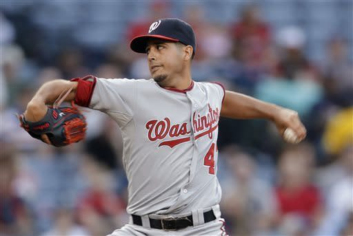 Washington Nationals starting pitcher Gio Gonzalez works in the first inning of a baseball game against the Atlanta Braves on Tuesday, April 30, 2013 in Atlanta. (AP Photo/John Bazemore)