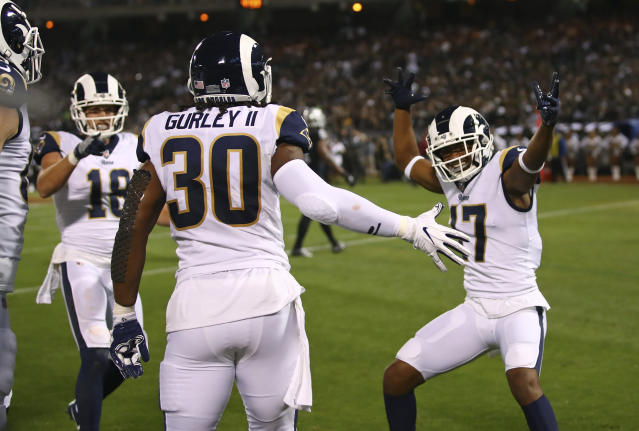 Los Angeles Rams running back Todd Gurley is greeted by teammates Cooper Kupp (18) and Robert Woods (17) after scoring a touchdown during the first half of an NFL football game against the Oakland Raiders in Oakland, Calif., Monday, Sept. 10, 2018. (AP Photo/Ben Margot)