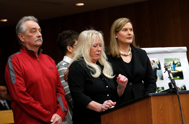 Assistant Attorney General Angela Povilaitis stands next to LaVonda Simon during a victim statement in memory of Simon's deceased daughter, Megan Simon, during the sentencing hearing of Larry Nassar, a former team USA Gymnastics doctor who pleaded guilty in November 2017 to sexual assault charges, in the Eaton County Court in Charlotte, Michigan, U.S., February 2, 2018. REUTERS/Rebecca Cook