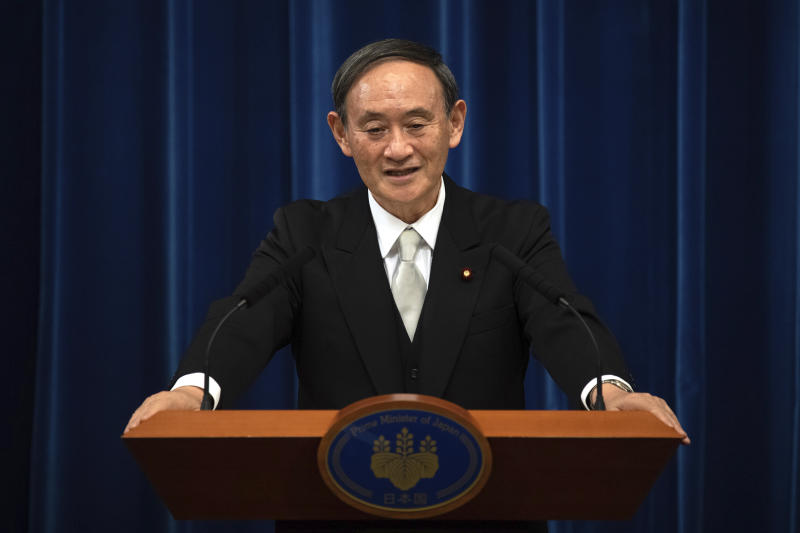 Japan's new Prime Minister Yoshihide Suga speaks during a press conference at the prime minister's official residence Wednesday, Sept. 16, 2020 in Tokyo, Japan. Suga, who was elected on Wednesday after gaining support for his pledges to pursue his predecessor Shinzo Abe's policies formed his 20-member Cabinet that retains many familiar faces, signaling continuation of Abe's line. (Carl Court/Pool Photo via AP)