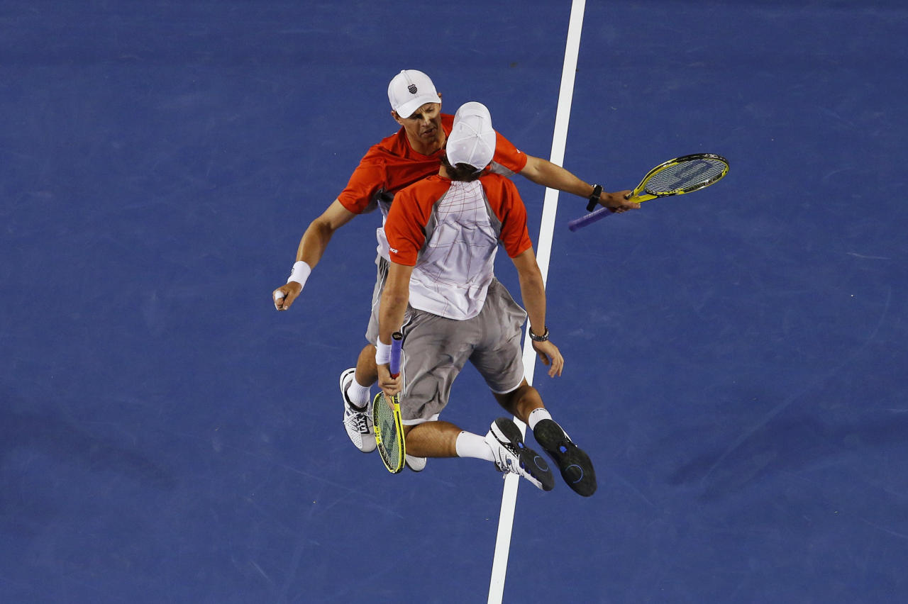 Bob (L) and Mike Bryan of the U.S. celebrate defeating Robin Haase and Igor Sijsling of Netherlands in their men's doubles final match at the Australian Open tennis tournament in Melbourne, January 26, 2013. REUTERS/David Gray (AUSTRALIA  - Tags: SPORT TENNIS TPX IMAGES OF THE DAY)   - RTR3CZCB