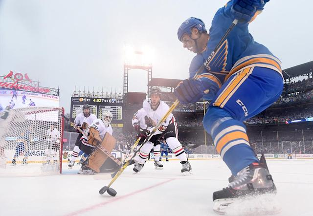 <p>ST LOUIS, MO – JANUARY 02: Ryan Reaves #75 of the St. Louis Blues controls the puck against Niklas Hjalmarsson #4 of the Chicago Blackhawks during the 2017 Bridgestone NHL Winter Classic at Busch Stadium on January 2, 2017 in St Louis, Missouri. (Photo by Brian Babineau/NHLI via Getty Images) </p>