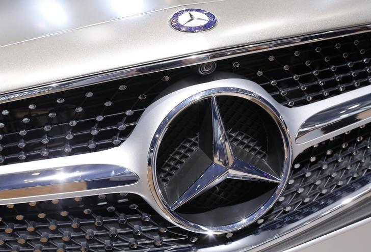 A Mercedes-Benz logo is seen on a car displayed on media day at the Paris Mondial de l'Automobile