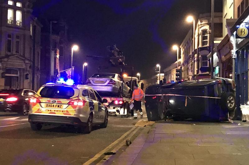 Overturned: Police had to close part of the road while the cars were removed (Christiano Takatsch)