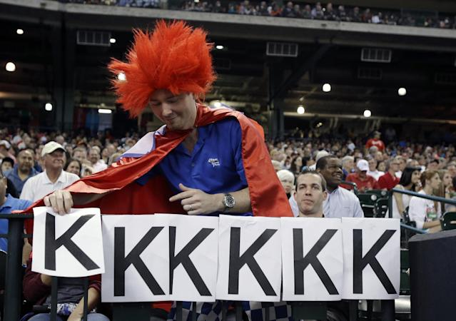 Texas Rangers fan Justin Kirby adds another K in the third inning of a baseball game against the Houston Astros after Rangers pitcher Yu Darvish struck out his sixth batter Tuesday, April 2, 2013, in Houston. Darvish struck out six of the first nine batters. (AP Photo/Pat Sullivan)