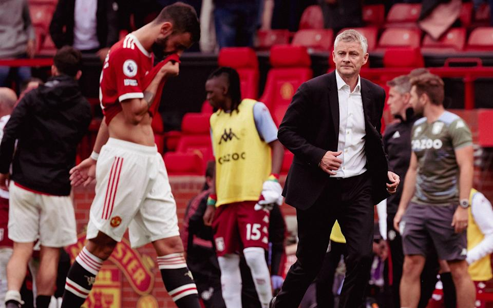 Ole Gunnar Solskjaer consoles Bruno Fernandes at the final whistle - Getty Images