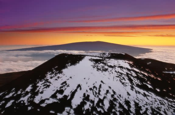 The view of Mauna Loa from the top of snow-peaked Mauna Kea, another Big Island volcano.