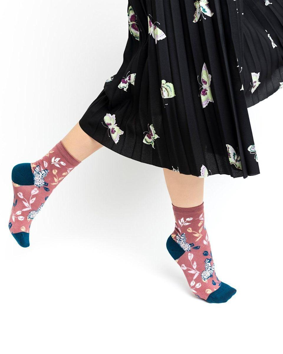 """<p>sockcandy.com</p><p><strong>$18.00</strong></p><p><a href=""""https://go.redirectingat.com?id=74968X1596630&url=https%3A%2F%2Fsockcandy.com%2Fproducts%2Ftossed-butterfly-sock&sref=https%3A%2F%2Fwww.countryliving.com%2Fshopping%2Fgifts%2Fg2190%2Fstocking-stuffers%2F"""" rel=""""nofollow noopener"""" target=""""_blank"""" data-ylk=""""slk:Shop Now"""" class=""""link rapid-noclick-resp"""">Shop Now</a></p><p>These fun and funky socks will perk up any wardrobe.</p>"""