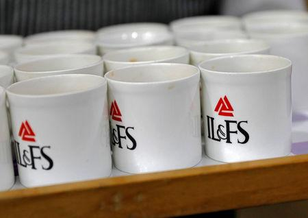 Logo of IL&FS is seen printed on mugs at its headquarters in Mumbai