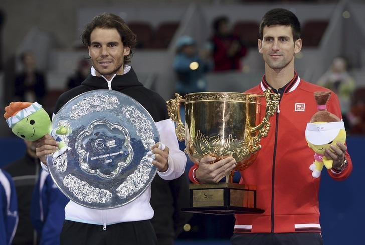 Winner Djokovic of Serbia and runner-up Nadal of Spain pose with their trophies during the award ceremony after the men's singles final match at the China Open Tennis Tournament in Beijing