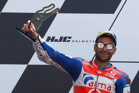 Motorcycling - MotoGP - French Grand Prix - Bugatti Circuit, Le Mans, France - May 20, 2018 Alma Pramac Racing's Danilo Petrucci celebrates with a trophy on the podium after the race REUTERS/Gonzalo Fuentes