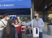 "Golden State Warriors coach Steve Kerr hands out ""I Voted"" stickers at a ballot drop-off station at Chase Center in San Francisco on Saturday, Oct. 31, 2020. (AP Photo/Janie McCauley)"
