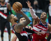 Portland Trail Blazers guard Damian Lillard, left, shoots as Washington Wizards guard Russell Westbrook defends during the second half of an NBA basketball game in Portland, Ore., Saturday, Feb. 20, 2021. (AP Photo/Craig Mitchelldyer)