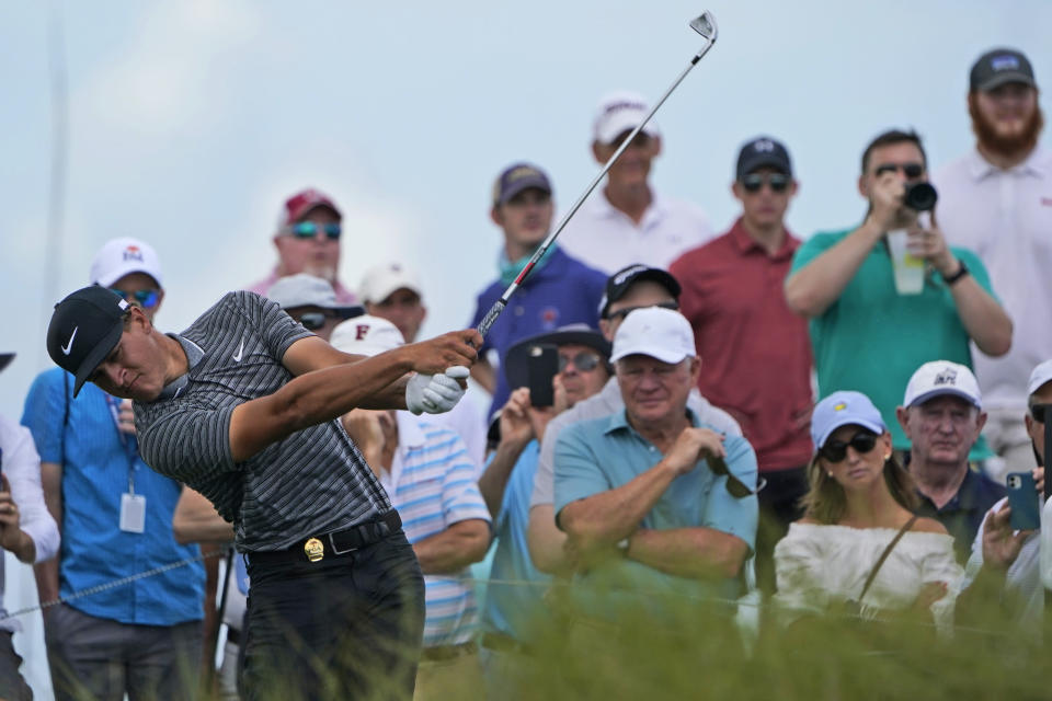 Cameron Champ hits his tee shot on the 17th hole during a practice round at the PGA Championship golf tournament on the Ocean Course Wednesday, May 19, 2021, in Kiawah Island, S.C. (AP Photo/Chris Carlson)