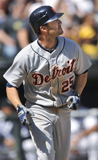 Detroit Tigers' Ryan Raburn watches his three-run home run against the Chicago White Sox in the sixth inning during a baseball game in Chicago, Tuesday, May, 15, 2012. Detroit won 10-8. (AP Photo/Paul Beaty)
