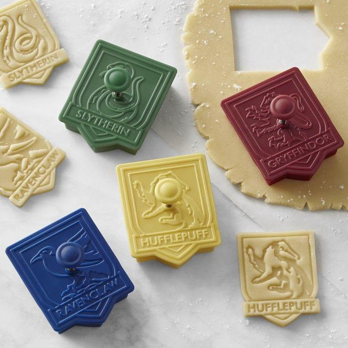 """<p><strong>Harry Potter</strong></p><p>williams-sonoma.com</p><p><strong>$9.99</strong></p><p><a href=""""https://go.redirectingat.com?id=74968X1596630&url=https%3A%2F%2Fwww.williams-sonoma.com%2Fproducts%2Fharry-potter-house-crest-cookie-cutters-set-of-4&sref=https%3A%2F%2Fwww.goodhousekeeping.com%2Fholidays%2Fgift-ideas%2Fg23595566%2Fharry-potter-gifts%2F"""" rel=""""nofollow noopener"""" target=""""_blank"""" data-ylk=""""slk:Shop Now"""" class=""""link rapid-noclick-resp"""">Shop Now</a></p><p>If your favorite fan is always in the kitchen, then they'll definitely appreciate this set of four Harry Potter cookie cutters. The knob makes them super easy to hold, and once the design is imprinted you can easily decorate them with icing in each house's colors!</p><p><strong>RELATED: </strong><a href=""""https://www.goodhousekeeping.com/holidays/gift-ideas/g28497189/best-gifts-for-foodies/"""" rel=""""nofollow noopener"""" target=""""_blank"""" data-ylk=""""slk:25 Amazingly Thoughtful Gifts for the Foodies in Your Life"""" class=""""link rapid-noclick-resp"""">25 Amazingly Thoughtful Gifts for the Foodies in Your Life</a></p>"""