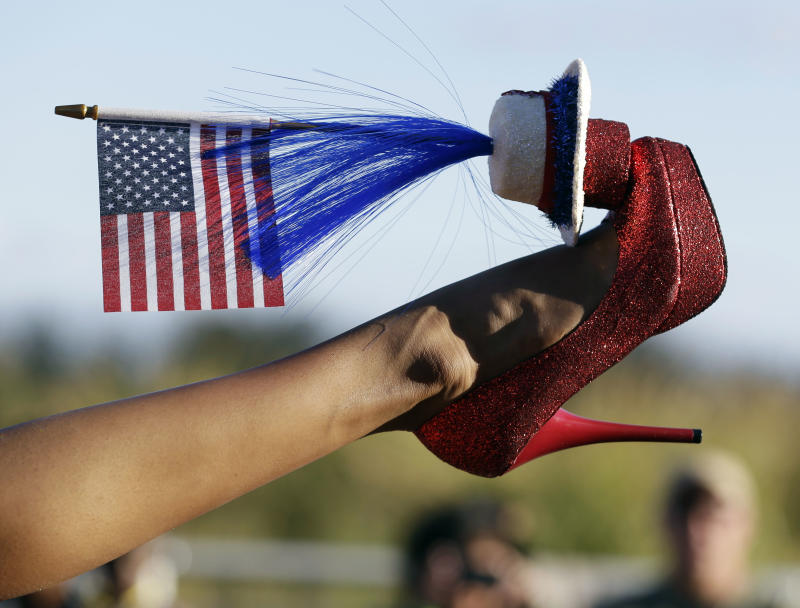 Miss District of Columbia Bindhu Pamarthi displays her shoe during the Miss America Shoe Parade at the Atlantic City boardwalk, Saturday, Sept. 14, 2013, in Atlantic City, N.J. (AP Photo/Julio Cortez)