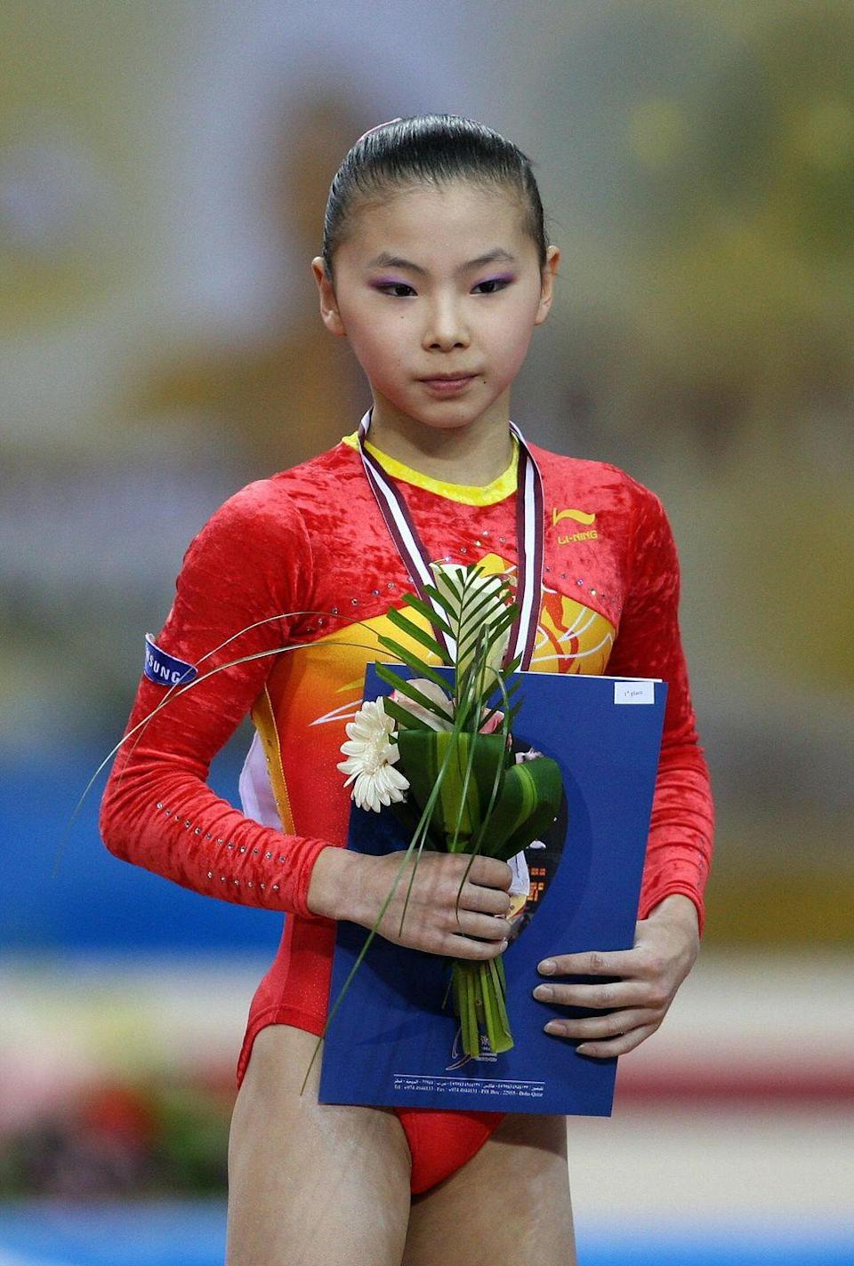 """<p>He Kexin won two gold medals at the Beijing Olympics, however an <a href=""""https://olympics.com/en/athletes/kexin-he"""" rel=""""nofollow noopener"""" target=""""_blank"""" data-ylk=""""slk:investigation"""" class=""""link rapid-noclick-resp"""">investigation</a> into the Chinese gymnast's age was the real headline grabber at the time. Kexin returned for competition in the 2012 Olympic games, winning a silver medal in the uneven bars. </p>"""