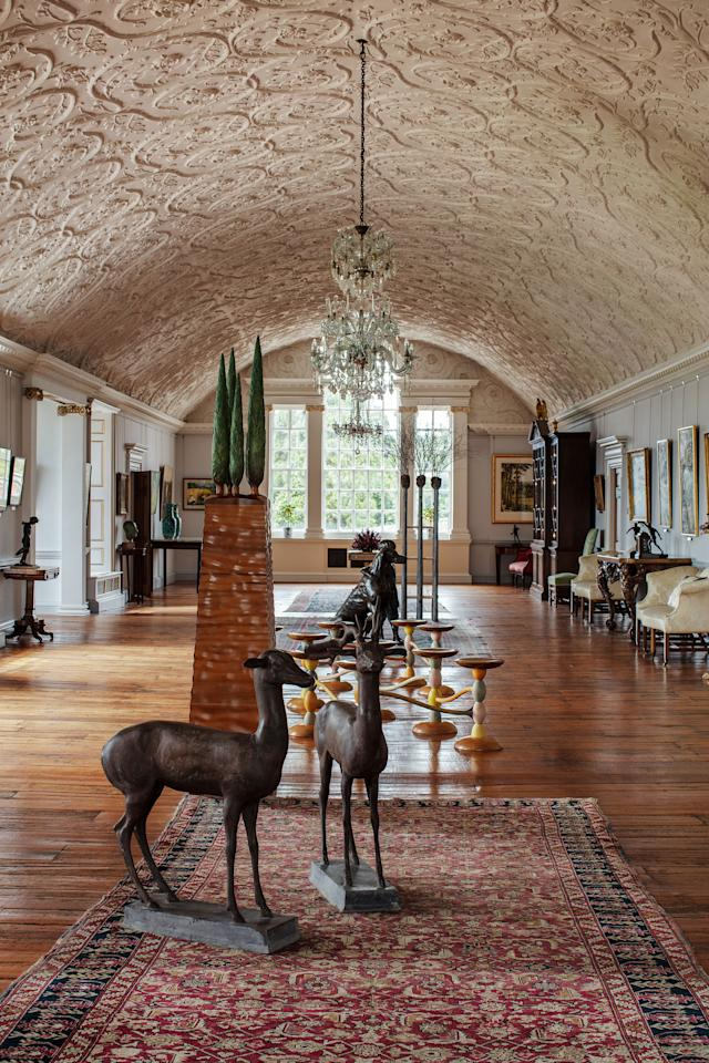 The long gallery, restored in the midcentury, serves as an art and furniture gallery.