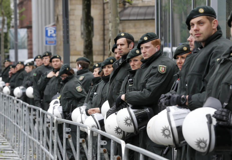 German police officers guard the Deutsche Bank building during a demonstration of some hundred anit-capitalism Blockupy protesters in front of the European Central Bank in Frankfurt, Friday, May 31, 2013. Members of the Blockupy group say they will try to prevent employees from reaching the ECB building for several hours Friday to highlight what they say is the bank's role in enforcing the harsh spending cuts introduced to tackle the euro area's three-year debt crisis. (AP Photo/Michael Probst)