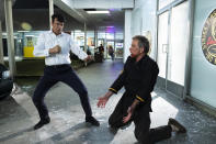 """CORRECTS SPELLING OF RALPH MACCHIO - This image released by Netflix shows Ralph Macchio, left, and Martin Kove in a scene from """"Cobra Kai."""" The program was nominated for an Emmy Award for outstanding comedy series. (Curtis Bonds/Netflix via AP)"""