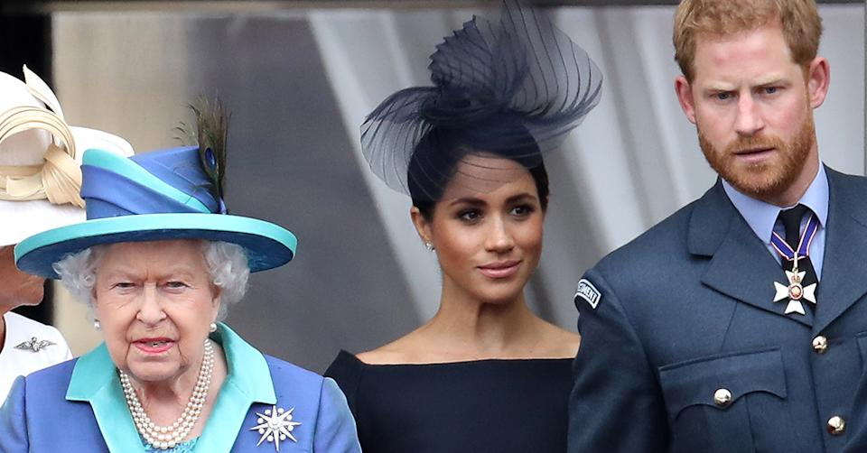 Queen Elizabeth II, Prince Harry, Duke of Sussex and Meghan, Duchess of Sussex on the balcony of Buckingham Palace as the Royal family attend events to mark the Centenary of the RAF on July 10, 2018 in London, England. (Photo by Chris Jackson/Getty Images)