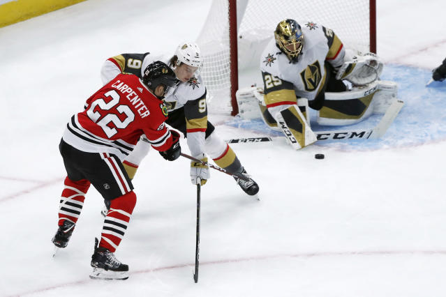 Vegas Golden Knights goaltender Marc-Andre Fleury, right, makes a save on a shot by Chicago Blackhawks center Ryan Carpenter as Cody Glass also defends during the first period of an NHL hockey game Tuesday, Oct. 22, 2019, in Chicago. (AP Photo/Charles Rex Arbogast)