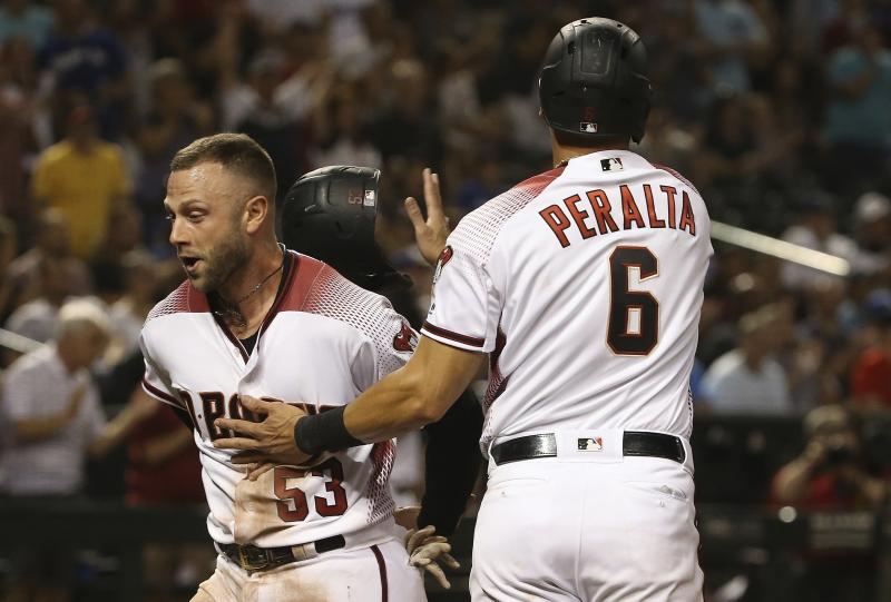 Arizona Diamondbacks' Christian Walker (53) and David Peralta (6) celebrate their runs scored against the Los Angeles Dodgers during the eighth inning of a baseball game, Monday, June 24, 2019, in Phoenix. (AP Photo/Ross D. Franklin)