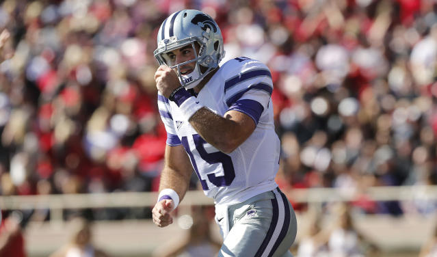 Kansas State's Jake Waters celebrates a touchdown against Texas Tech during the first half of an NCAA college football game in Lubbock, Texas, Saturday, Nov. 9, 2013. (AP Photo/Lubbock Avalanche-Journal, Stephen Spillman)
