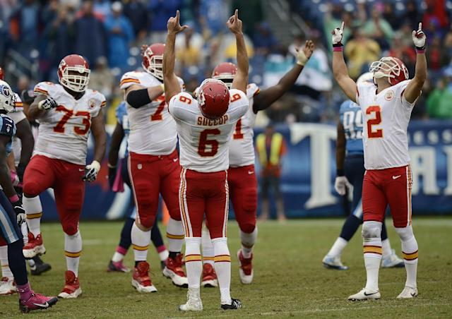 Kansas City Chiefs kicker Ryan Succop (6) and holder Dustin Colquitt (2) celebrate after Succop made a 48-yard field goal to seal a 26-17 win over the Tennessee Titans in the final minutes of the fourth quarter of an NFL football game on Sunday, Oct. 6, 2013, in Nashville, Tenn. (AP Photo/Mark Zaleski)