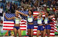 <p>(L-R) Natasha Hastings, Phyllis Francis, Allyson Felix and Courtney Okolo of the United States react after winning gold in the Women's 4 x 400 meter Relay on Day 15 of the Rio 2016 Olympic Games at the Olympic Stadium on August 20, 2016 in Rio de Janeiro, Brazil. (Photo by Cameron Spencer/Getty Images) </p>