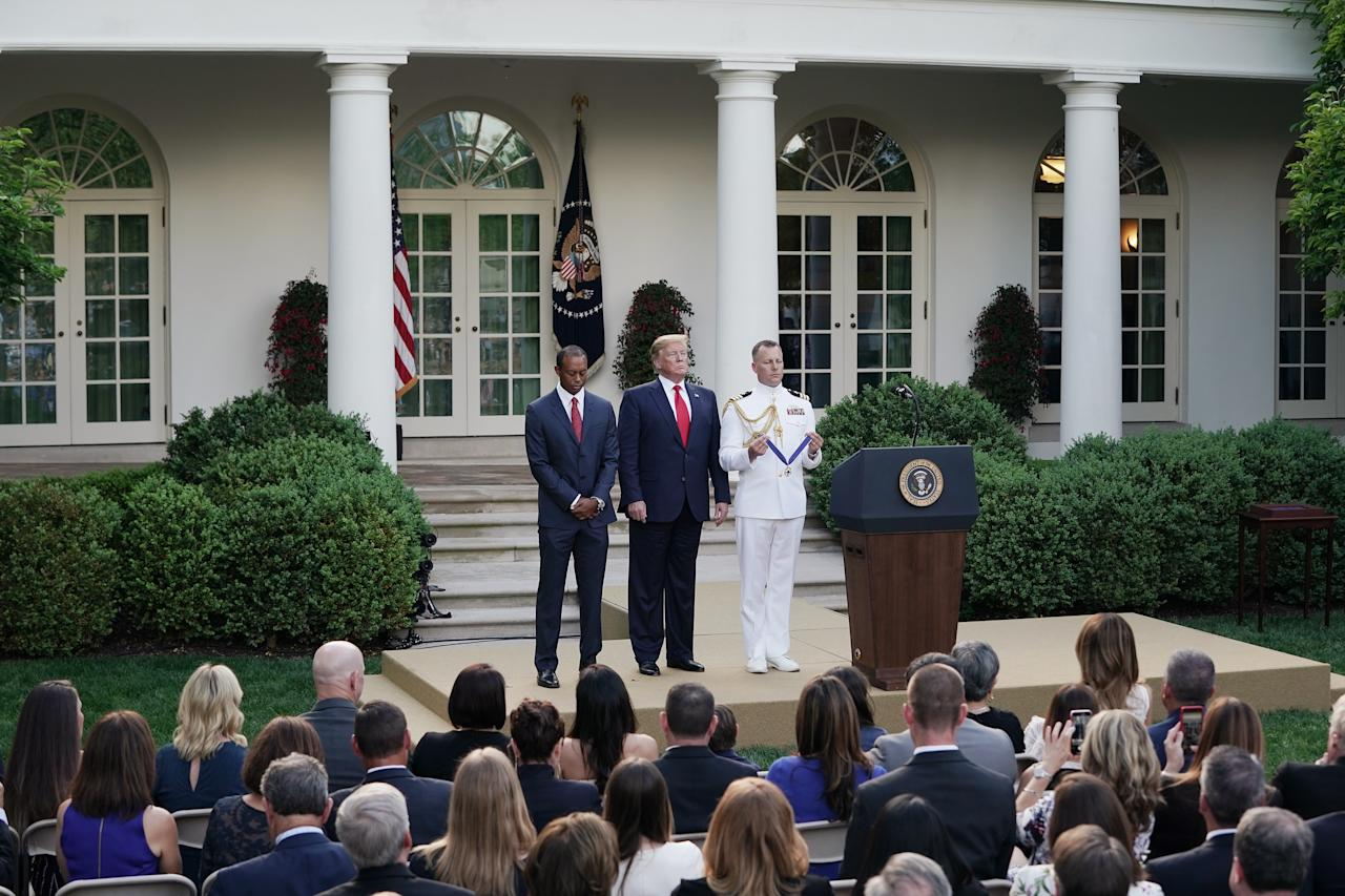 U.S. President Donald Trump gives professional golfer and business partner Tiger Woods the Medal of Freedom during a ceremony in the Rose Garden at the White House May 06, 2019 in Washington, DC. Trump announced he would give the nation's highest civilian honor to Woods, 43, in honor of his Masters victory last month. (Photo by Chip Somodevilla/Getty Images)