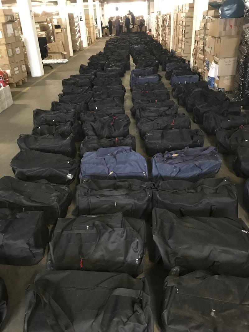 In this handout photo from July, 2019 German customs authorities seize 4.5 tons (nearly 5 U.S. tons) of cocaine in a container shipped in Hamburg, Germany, from Uruguay, a haul with an estimated street value of nearly 1 billion euros ($1.1 billion). The customs office in Hamburg says that the drugs were seized two weeks ago when it checked the container that was en route from Montevideo to Antwerp, Belgium. (German Custom via AP)