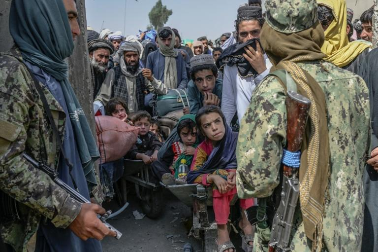 The new Taliban rulers insist Afghans need to stay and rebuild their conflict-ravaged country (AFP/BULENT KILIC)