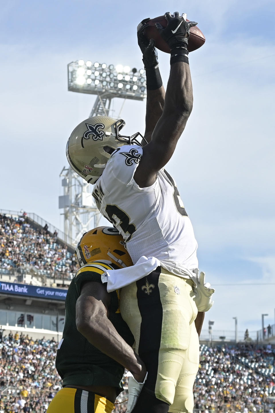 New Orleans Saints tight end Juwan Johnson, right, reaches up for a touchdown reception over Green Bay Packers strong safety Adrian Amos, left, during the first half of an NFL football game, Sunday, Sept. 12, 2021, in Jacksonville, Fla. (AP Photo/Phelan M. Ebenhack)