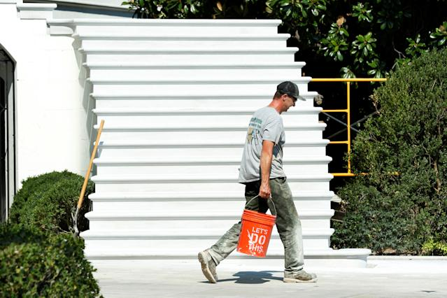 <p>A worker walks past the South Portico porch stairs of the White House after a renovation in Washington, Aug. 22, 2017. (Photo: Yuri Gripas/Reuters) </p>