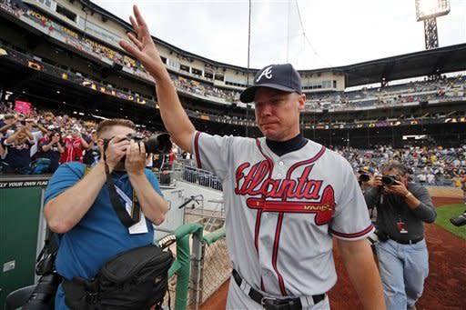 Atlanta Braves' Chipper Jones acknowledges fans as he heads for the clubhouse following a 4-0 win over the Pittsburgh Pirates in the final baseball game of the regular season in Pittsburgh Wednesday, Oct. 3, 2012. (AP Photo/Gene J. Puskar)