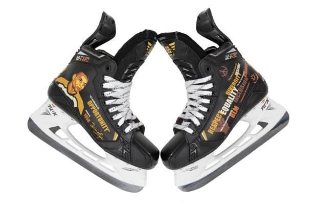 The skates picture Willie O'Ree and inspirational messages.