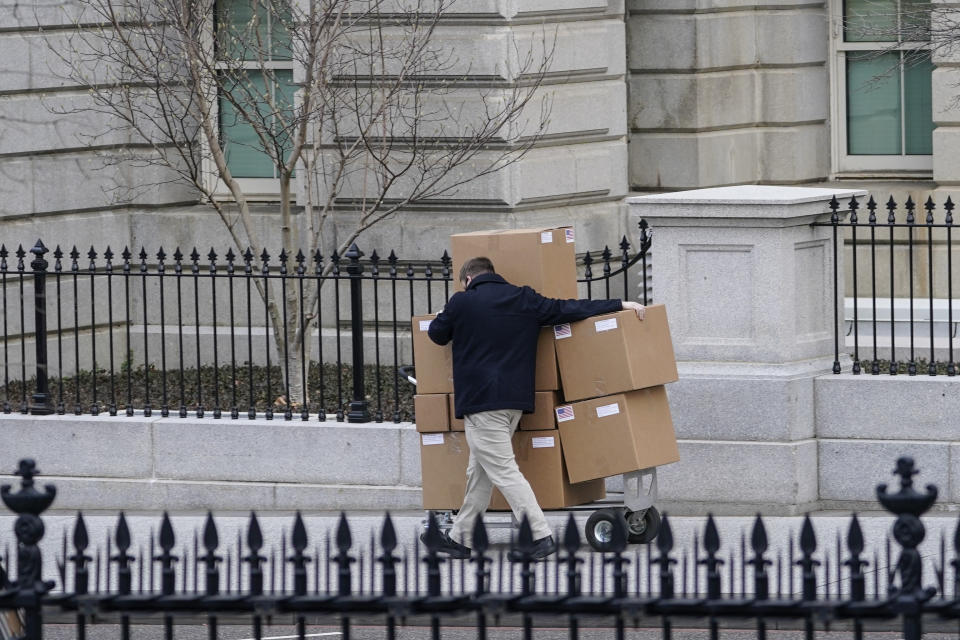 WASHINGTON, DC - JANUARY 15: A man pushes a large cart full of boxes along West Executive Avenue between the West Wing of the White House and the Eisenhower Executive Office Building on January 15, 2021 in Washington, DC. According to recent news reports, President Donald Trump is slated to leave Washington the morning of Jan. 20th, hours before President-elect Joe Biden will be sworn-in as president. (Photo by Drew Angerer/Getty Images)