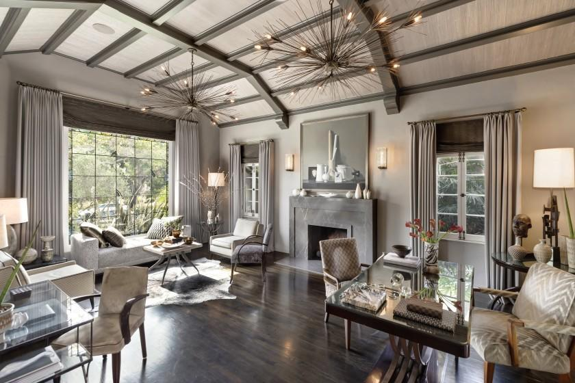 "Eye-catching fixtures and fabric ceiling panels keep the eyes moving upward at the Miracle Mile home of interior designer Jeff Andrews and casting director Ken Miller. The Spanish Colonial Revival-style house is now on the market for $2.35 million. <span class=""copyright"">(PostRAIN Productions)</span>"