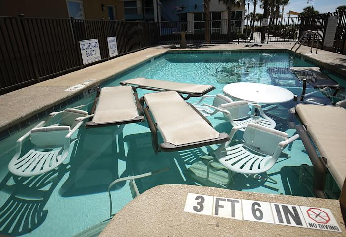 <p>Poolside furniture is placed in the pool of a hotel ahead of the approaching Hurricane Florence on Sept. 12, 2018 in Myrtle Beach, S.C. (Photo: Mark Wilson/Getty Images) </p>