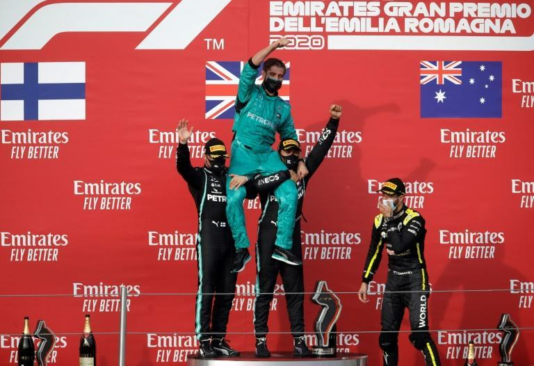 Hamilton and Bottas celebrate title record with a Mercedes mechanic