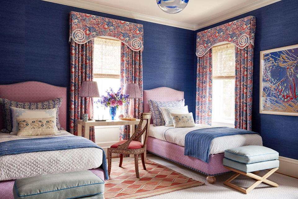 """<p>Designer <a href=""""https://www.veranda.com/decorating-ideas/a27105026/katie-ridder-hamptons-home/"""" rel=""""nofollow noopener"""" target=""""_blank"""" data-ylk=""""slk:Kate Ridder's Hampton home"""" class=""""link rapid-noclick-resp"""">Kate Ridder's Hampton home</a> is all about awe-inspiring color clashes, and we adore this blend of orchid pink and cobalt blue, plus all the fun texture and pattern happening across the space. Drapery and bed fabric are from <a href=""""https://studiofournyc.com/"""" rel=""""nofollow noopener"""" target=""""_blank"""" data-ylk=""""slk:Studio Four"""" class=""""link rapid-noclick-resp"""">Studio Four</a>, while the vintage rug is <a href=""""https://www.mmf.se/"""" rel=""""nofollow noopener"""" target=""""_blank"""" data-ylk=""""slk:Märta Måås-Fjetterström"""" class=""""link rapid-noclick-resp"""">Märta Måås-Fjetterström</a>.</p>"""