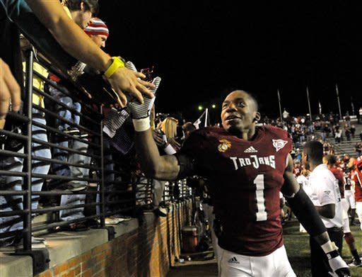 Troy defensive back Camren Hudson (1) celebrates with fans after an NCAA college football game against Navy in Troy, Ala., Saturday, Nov. 10, 2012. Troy won 41-31.(AP Photo/The (Troy)