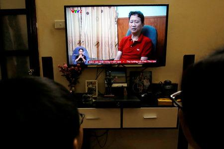 FILE PHOTO: An image of Vietnamese former oil executive Trinh Xuan Thanh is seen on a TV screen on state-run television VTV, saying he turns himself in at a police station in Hanoi